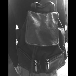 Kenneth Cole Black Leather/Rubberized  Backpack